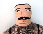 tattooed man doll