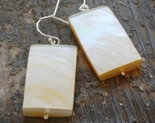 simple cream shell earrings. rectangle shells on sterling silver by val b.