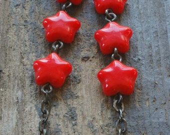 red hot stars earrings. czech glass on oxidized sterling silver by val b.