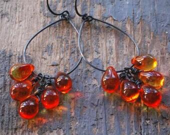 fire opal cluster hoop earrings. czech glass on oxidized sterling silver by val b.