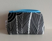 Closing Sale - Black and white abstract peacock print zipper pouch.