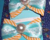 Pearl bow barettes
