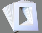 25 8x10 mats for a 5x7 image in assorted White and Creams