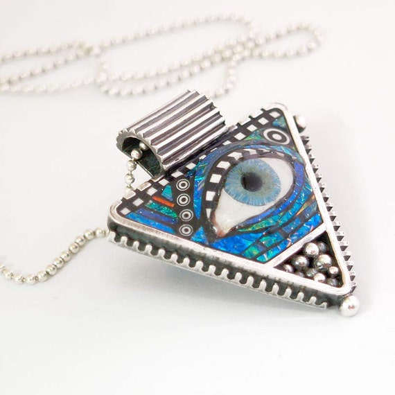 Silver Triangle Pendant with Eye inlaid with Blue Green Iridescent Mosaic Polymer