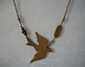 PEACE- an art jewelry flying bird necklace in antique gold and black