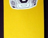 Yellow Notepad with Boom box