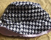 Reversible kids crusher hat in houndstooth and pink satin