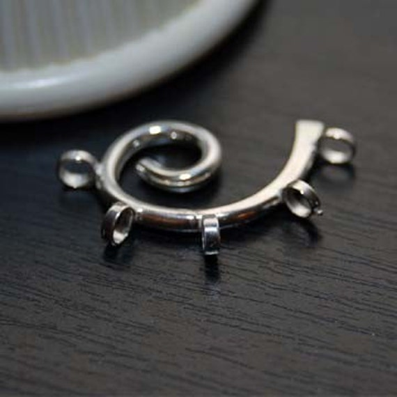 winding -- sterling silver pendant
