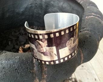 filmstrip design metal cuff bracelet with printing inside the cuff
