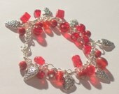 Strawberries beaded charm bracelet