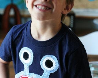 Blue Bernard monster on Navy Tee sizes 2, 4, 6, 8, 10, 12