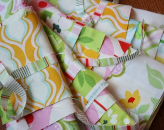 A  Nicey Jane Mini Fabric Pack.  A Selection of Small Cuts from the Beautiful Collection by Heather Bailey for Freespirit Fabrics.