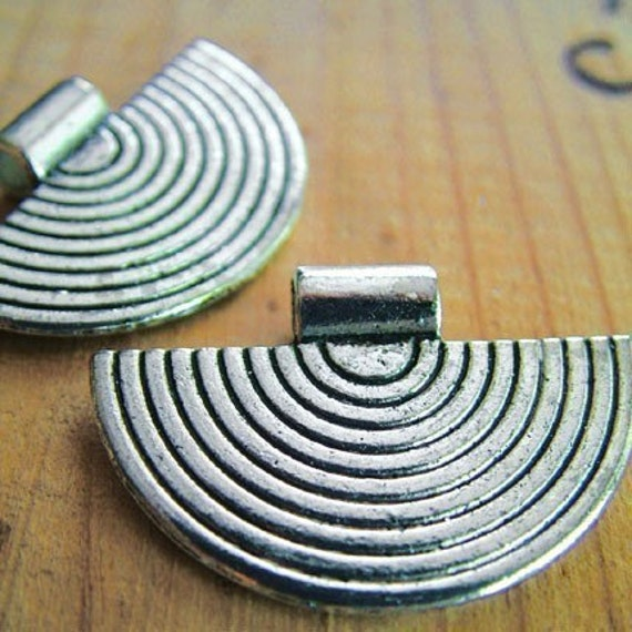 silver finish tribal boho pendants in my Etsy shop