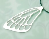 silver butterfly wing pendant on green silk