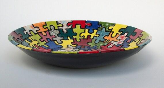 large ceramic serving bowl with puzzle pieces. Black Bedroom Furniture Sets. Home Design Ideas