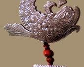 Aluminum Frida  Fish Milagro Ornament, featured in ARTitude zine, Issue 24, Spring 2007