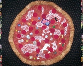 A Pizza with everything - be careful what you wish for - Art Quilt by Tina Marie Rey