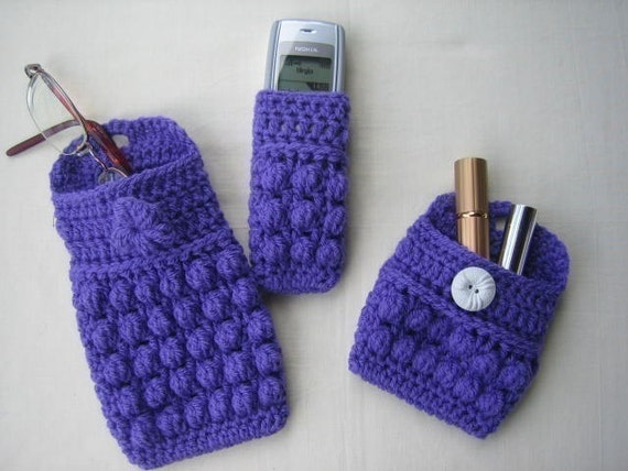 Nifty Gifts  (crochet patterns) glasses case, phone cosy, make up case, and business card case