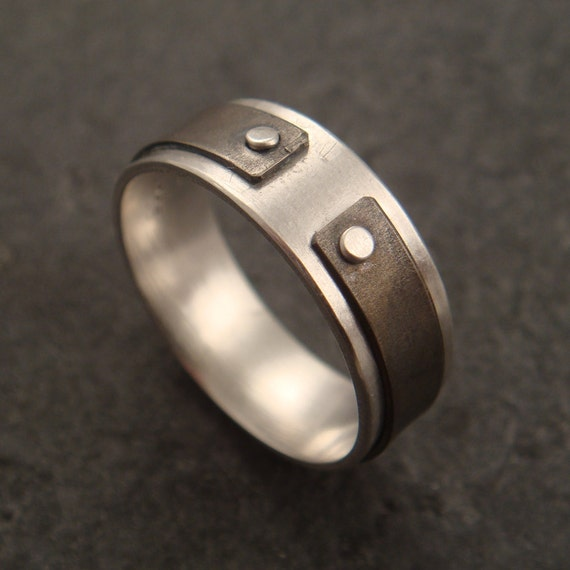 Narrow the Gap Ring: a ring in sterling silver and titanium