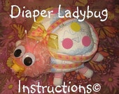 Learn to make a Ladybug from diapers, socks, etc. diaper cake keepsake. GR8 baby shower gift