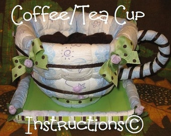 INSTRUCTIONS 4 a diaper cake Coffee/Tea Cup. GR8 new baby gift. Make it and fill it up with baby/mommy goodies