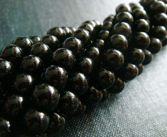6mm Black Onyx Smooth Rounds - 11 inch Strand