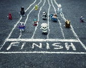The Wind Up Race - vintage, wind-up, toys, toy photography, robot, skull, boxer, winning, win, headband, race, fine art