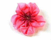 cherry pink ribbon flower brooch with beaded centre