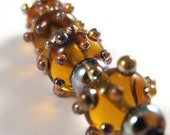 Handmade Amber Glass Beads with Aurae Accents