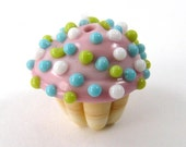 Handmade Vanilla Glass Cupcake Bead With Pink Frosting and Turquoise and Lime Green and White Sprinkles