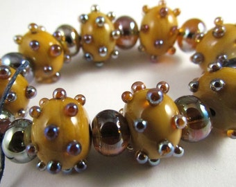 Free Shipping for this set of Eight Handmade Dark Ivory Glass Beads with Aurae Accents