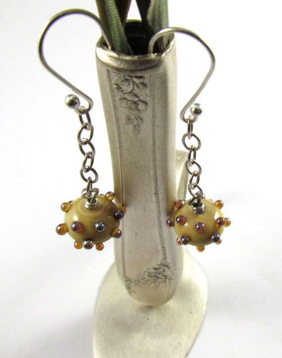 Free Shipping for this Lovely Pair of Earrings Made with Ivory Glass with Aurae Accents