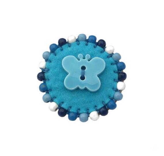 Brooch, small round blue felt (W-BRO-019)