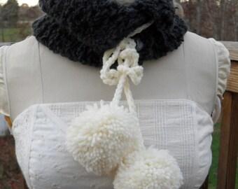 Dark gray curly yarn neckwarmer with big white pom poms