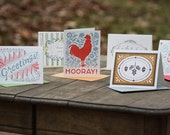 seven assorted letterpress greeting cards
