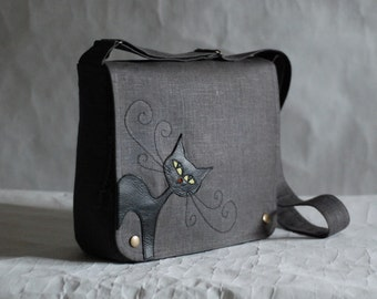 Grey messenger bag with black cat