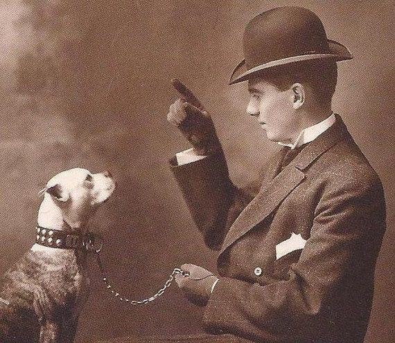 Postcard with reproduction c1910 vintage image of a bowler hatted man and boxer dog