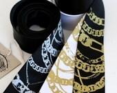 Fool's Gold. Silkscreen chain necktie. Choose black or white. Standard, narrow or skinny width.