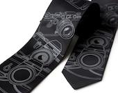 Camera necktie. Men's black tie, silkscreened old film camera print. Choose standard, narrow or skinny size. Microfiber tie.