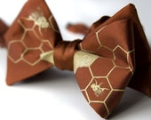 Oh Honey bow tie. Coppery brown bow tie, self-tie. Silkscreened beehive. Gold screen print. Adjustable.