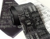 Rocket Science men's necktie. Apollo cockpit silkscreened microfiber tie. Dove gray ink. Choose black, charcoal or white.