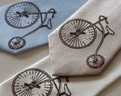 High Wheel Bicycle necktie. Penny Farthing bike tie, hiwheel. Bronze print on champagne, cream, sky blue & more. Screen printed necktie.