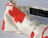 Poppy bow tie. Cream and dark coral freestyle & adjustable tie. Silkscreened floral necktie.