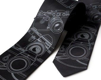 Camera necktie. Men's black tie, silkscreened old film camera print. Choose standard, narrow or skinny size. Microfiber tie.