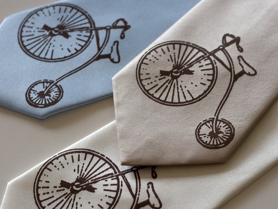 High Wheel Bicycle necktie. Penny Farthing bike tie, hiwheel. Bronze print on champagne, cream, sky blue & more. Screen printed necktie.