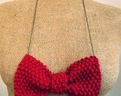 bow tie statement necklace in red knit yarn