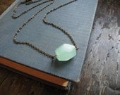 glass pendant necklace in mint green with a minimal style on steel chain