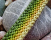 Green and yellow friendhsip bracelet with stripes