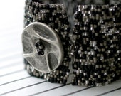Tweed ... Bracelet . Cuff . Italian Button . Black . Gray . Classic . Stylish . Versatile . Dressy . Casual . Comfortable