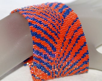 To and Fro ... Peyote Bracelet . Brilliant Orange . Midnight Blue . Waves . Rays. Contrasting Colors . Flowing Design . Dramatic . Everyday